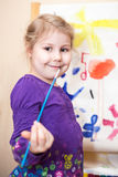 Happy preschool girl painting a picture Stock Photography