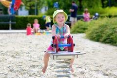 Happy preschooler girl having fun at playground Royalty Free Stock Photos