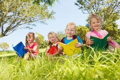 Happy preschoolers. Happy children with books at park Royalty Free Stock Images