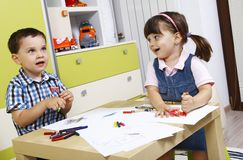 Happy preschoolers who draws with crayons Royalty Free Stock Image