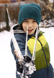 Happy preteen boy with icicles winter background Stock Images