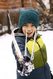 Happy preteen boy with icicles winter background Royalty Free Stock Photo