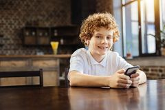 Happy preteen boy listening to music at home Stock Image