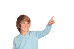 Happy preteen boy pointing something Stock Images