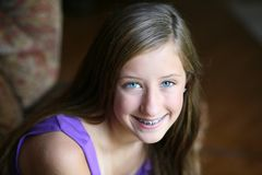 Happy preteen girl with braces Stock Images