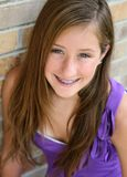 Happy preteen girl with braces. Beautiful young girl smiling with braces Stock Photography