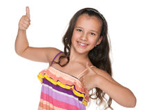 Happy preteen girl holds her thumbs up. A happy preteen girl holds her thumbs up on the white background Stock Images