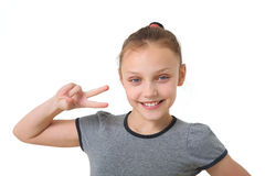 Happy preteen girl. Portrait of a preteen girl smiling and showing peace sign on a white background Stock Images