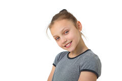 Happy preteen girl. Portrait of a preteen girl smiling and  on a white background Royalty Free Stock Photo