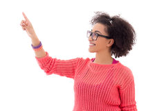 Happy pretty african american teenage girl in pink pointing at s Stock Images