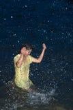 Happy pretty Asian woman having fun in the sea. Stock Photos