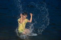 Happy pretty Asian woman having fun in the sea. Royalty Free Stock Photos