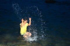 Happy pretty Asian woman having fun in the sea. Stock Image