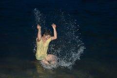 Happy pretty Asian woman having fun in the sea. Stock Photography