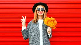 Happy pretty autumn cool girl with yellow maple leaves Royalty Free Stock Image
