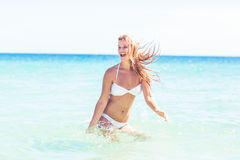 Happy pretty blonde bathing into the sea Royalty Free Stock Photography