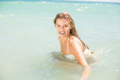 Happy pretty blonde bathing into the sea Stock Images