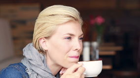 Happy pretty blonde drinking coffee. In high quality 4k format stock video