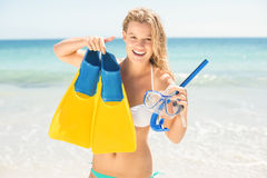 Happy pretty blonde holding mask, scuba and fins Stock Photos