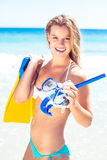 Happy pretty blonde holding mask, scuba and fins Stock Image
