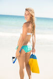 Happy pretty blonde holding mask, scuba and fins Stock Images