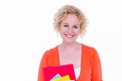 Happy pretty blonde holding notebook Stock Images