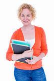 Happy pretty blonde holding notebook Royalty Free Stock Image