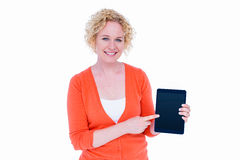 Happy pretty blonde showing tablet computer Stock Photography