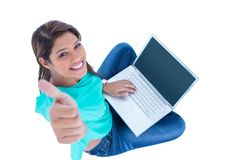 Happy pretty brunette looking at camera with thumbs up Royalty Free Stock Images