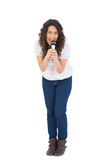 Happy pretty brunette singing with her microphone Royalty Free Stock Photo