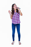 Happy pretty brunette singing on microphone Royalty Free Stock Image