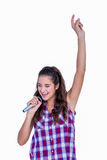 Happy pretty brunette singing on microphone Stock Photography