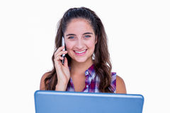Happy pretty brunette using tablet computer and having phone call Royalty Free Stock Photography