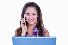 Happy pretty brunette using tablet computer and having phone call Royalty Free Stock Images