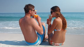 Happy pretty couple drinking cocktail stock footage