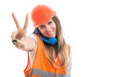 Happy pretty engineer having a conversation on telephone Royalty Free Stock Photography