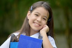 Happy Pretty Filipina Person With Books. An attractive and asian person stock photo
