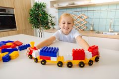Happy pretty girl building a train royalty free stock image