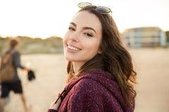 Happy pretty girl enjoying walking. On a beach Royalty Free Stock Photos