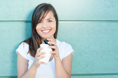 Happy pretty girl holding cup of takeaway coffee Royalty Free Stock Images
