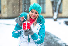 Happy pretty girl holding a red present Stock Photography