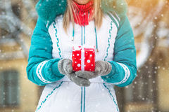 Happy pretty girl holding a red present Royalty Free Stock Photos