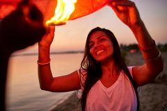 Happy pretty girl holding sky lantern with friend royalty free stock photography