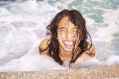 Happy Pretty Girl in Spa. Pretty girl with a big smile in spa with foamy, bubbly water Royalty Free Stock Photo