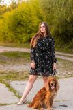 Happy pretty girl at sunset. Fine art photo of a gorgeous lady with dog in a mysterious forest royalty free stock photography