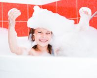 Happy pretty girl is taking a bath Royalty Free Stock Photos