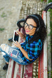 Happy pretty girl using tablet pc and headphones listening to mu Royalty Free Stock Photo