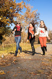 Happy pretty girls in the park Stock Images