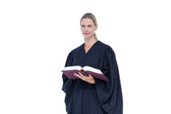 Happy pretty lawyer holding labor code. On white background Royalty Free Stock Photo