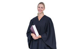 Happy pretty lawyer holding law code Royalty Free Stock Photos